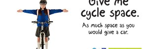 Picture of a schoolgirl on a bike with arms outstretched