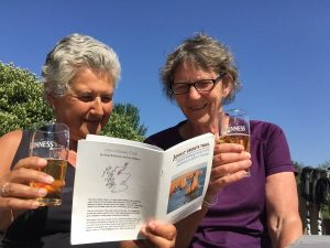 Sandra (left) and Mum-checking out the draft JOGT guidebook after Day 2, beer in hand.